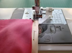 Use of a blind foot (?) to get stitching an even distance from the edge of the binding