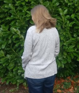 Back view of Swoon scarf neck cardigan
