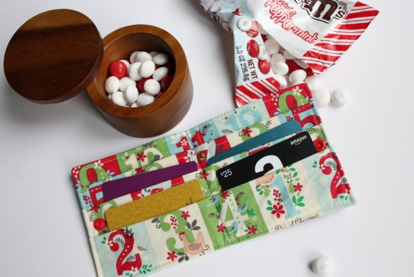 Candy Wrapper Gift Card Wallet Tutorial: This tutorial lets you eat lots of delicious candy! Use the wrappers to create a cute gift card wallet to fill with gift cards and gift to your favorite person! Click through for the full sewing tutorial. | www.sewwhatalicia.com