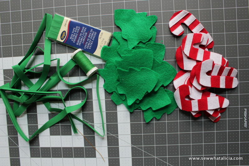 Candy Cane Felt Christmas Garland: This is a quick and easy garland tutorial that is great for hanging all over the house! Try it on your tree or over the mantle. Click through for the full tutorial and a free cut file. | www.sewwhatalicia.com