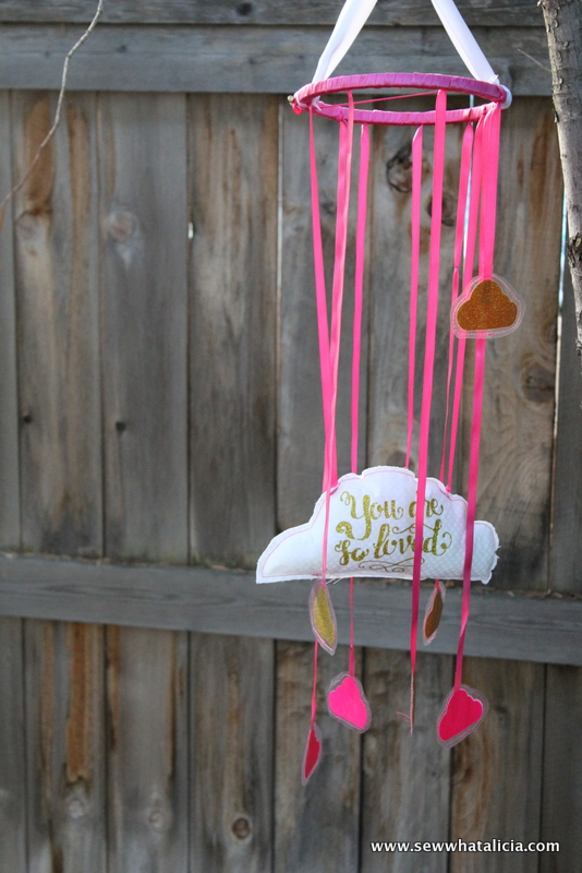 DIY Baby Mobile Sewing Tutorial: This is a fun tutorial that will make a great conversation piece for your little one's nursery. You could also use it in a big girl room because it has a really sweet message! Click through for the full tutorial. | www.sewwhatalicia.com