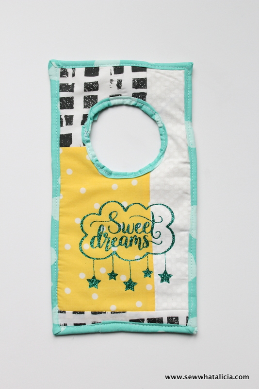 Fabric Doorknob Hanger Tutorial: Add a sweet touch to your little one's nursery with this doorknob hanger. Click through for the full sewing tutorial.   www.sewwhatalicia.com