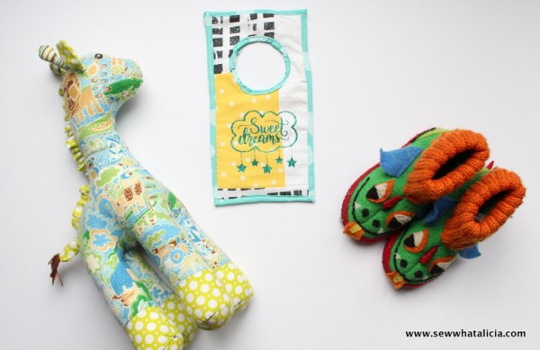 Fabric Doorknob Hanger Tutorial: Add a sweet touch to your little one's nursery with this doorknob hanger. Click through for the full sewing tutorial. | www.sewwhatalicia.com