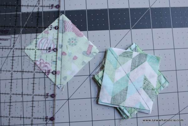 "How to make a Christmas cactus wall hanging tutorial: This wall hanging uses half square triangles to ""draw"" a cactus. This is a great sewing tutorial for anyone new to quilting. Click through for the full tutorial. 