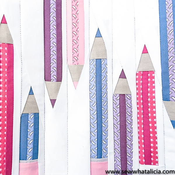 Drawstring Backpack Sewing Tutorial - Pencil Paper Piecing: This sewing tutorial is perfect for back to school. Click through for the full tutorial and learn to paper piece pencils and sew together a cute drawstring backpack with the quilt block. | www.sewwhatalicia.com