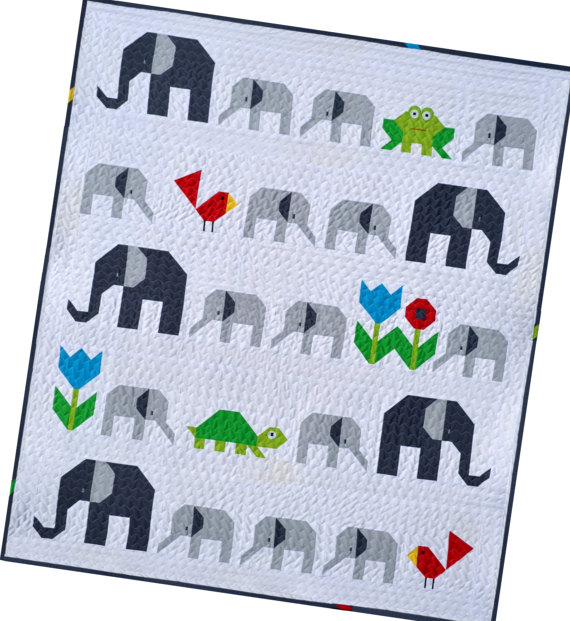 pictured quilt with elephants and frogs
