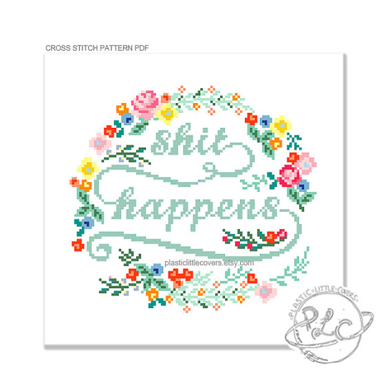 pictured cross stitch pattern reading shit happens with floral frame