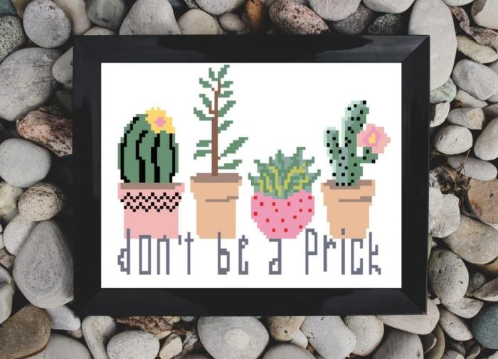 pictured cross stitch reading don't b a prick with four cactus framed on a rock background