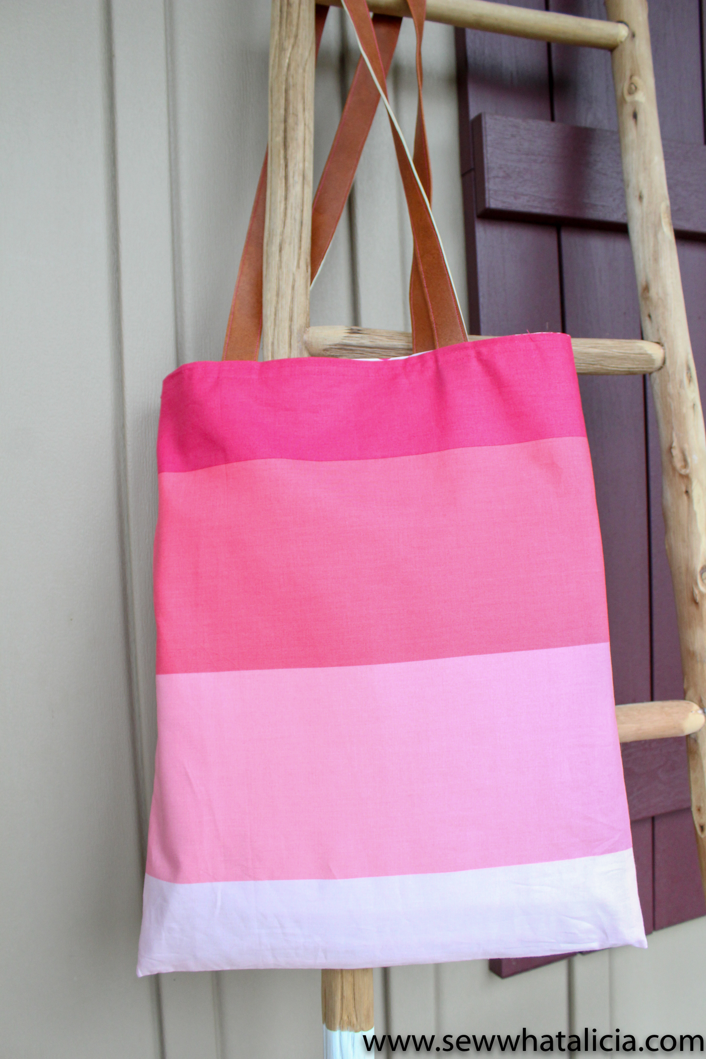 How to make a tote bag: Finished beauty shot of tote hanging on ladder. | www.sewwhatalicia.com