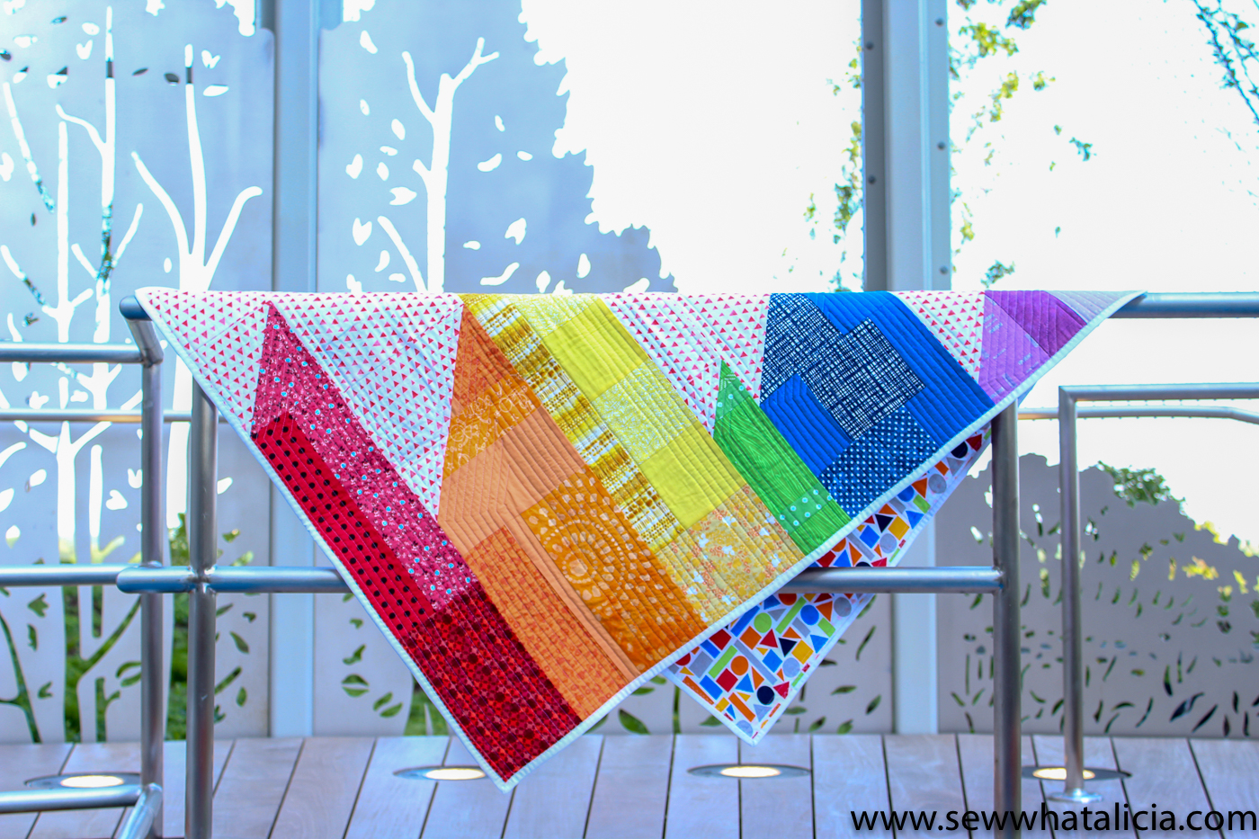 Scrappy Easy Rainbow Quilt Pattern and Tutorial: This easy quilt pattern is perfect for beginner sewing fanatics. Click through for the PDF pattern and all the instructions. | www.sewwhatalicia.com