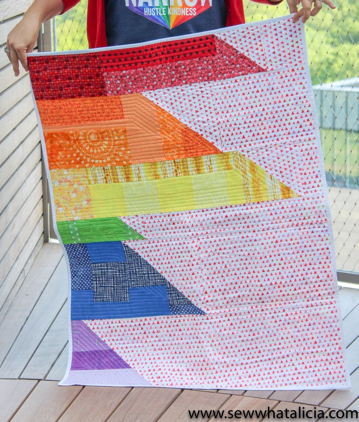 Scrappy Easy Rainbow Quilt Pattern and Tutorial: This easy sewing pattern is also a free sewing pattern. This beginner sewing tutorial is perfect for those who want to quilt a rainbow baby blanket to give as a gift. Click through for the free sewing pattern and a full tutorial. | www.sewwhatalicia.com