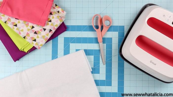 Pictured: Fabric, Fusible Fleece, Scissors, Cricut EasyPress