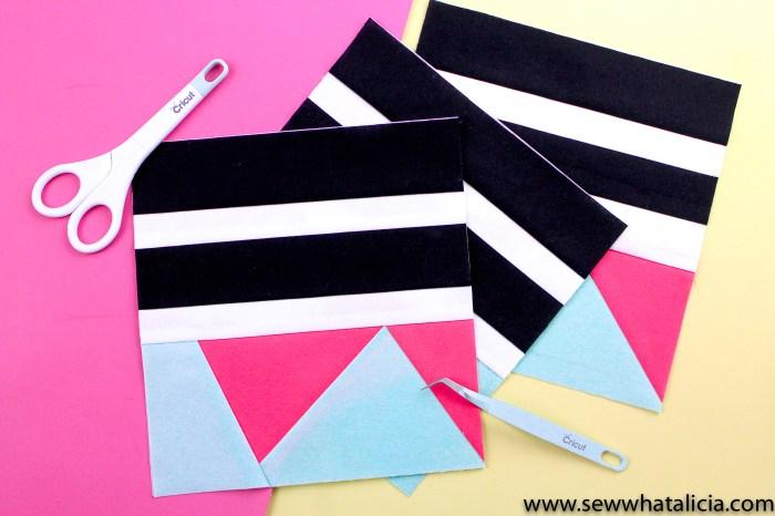 Pictured three quilt blocks in white, black, pink, and aqua. Scissors and tweezers.