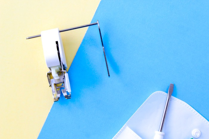 pictured: walking foot with quilting guide attached on blue and yellow background