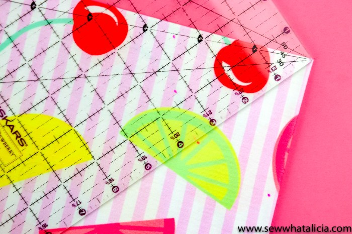 pictured: retro fruit salad fabric and a clear ruler