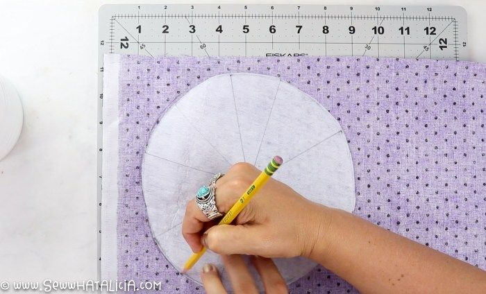 pictured purple fabric, interfacing circle, and pencil tracing the circle