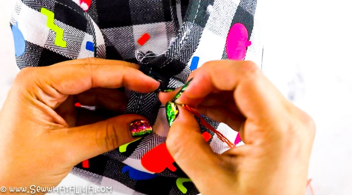 pictured hands performing long running stitch around top edge
