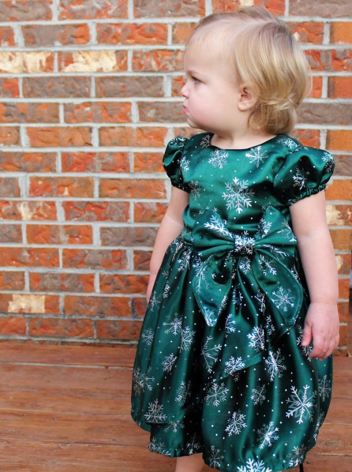 pictured young girl in poinsettia dress