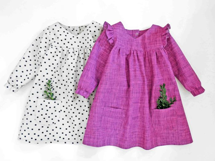 pictured pink dress and white dress with greenery in pockets