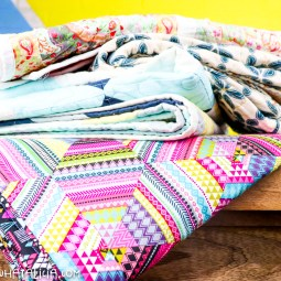 pictured stack of quilts on table