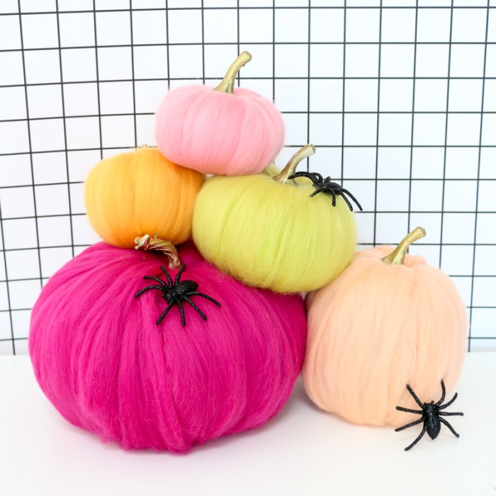 pumpkins wrapped with wool roving yarn