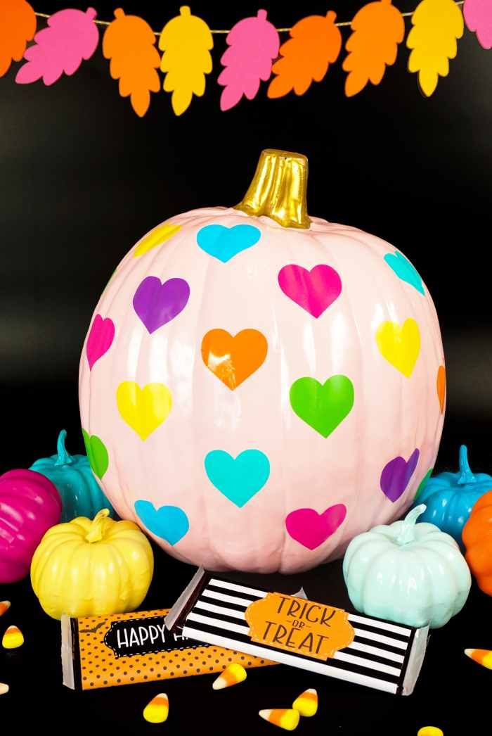 craft pumpkin with vinyl hearts in rainbow colors