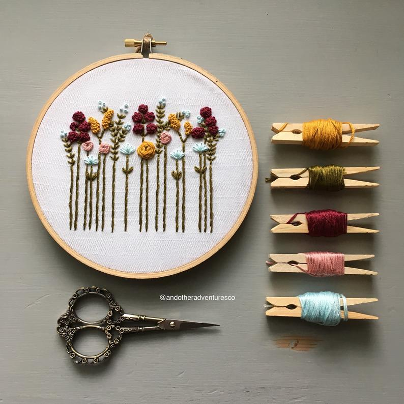 embroidery hoop with fall colored wild flowers