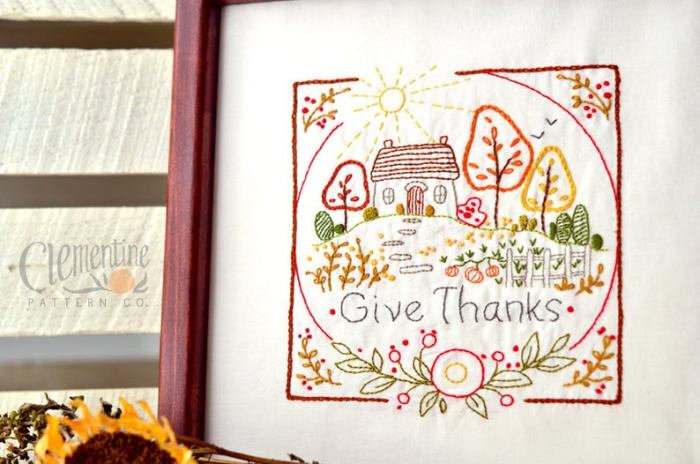 cottage and fall trees embroidered and framed