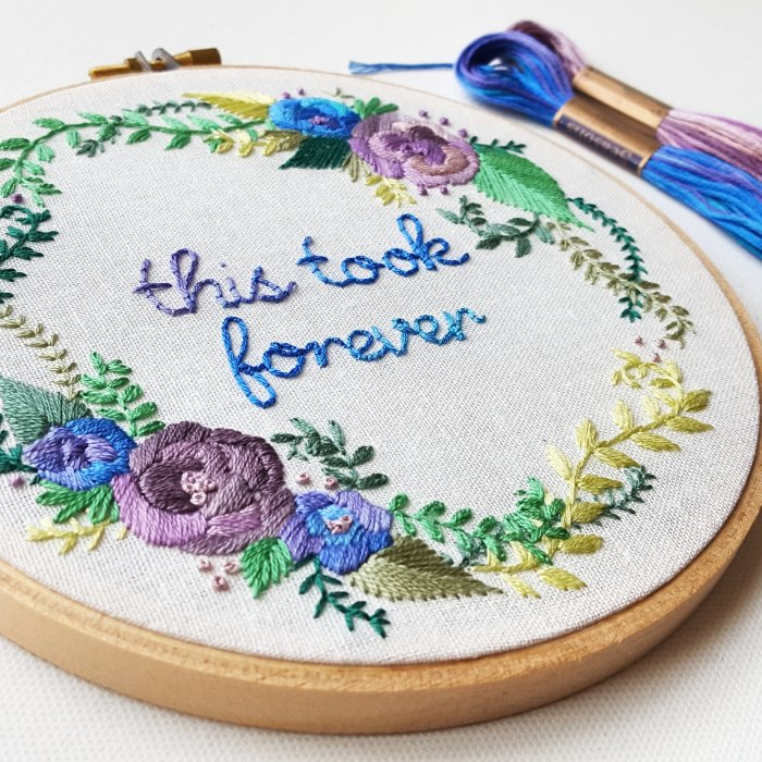 pictured embroidery hoop with this took forever script and floral accents