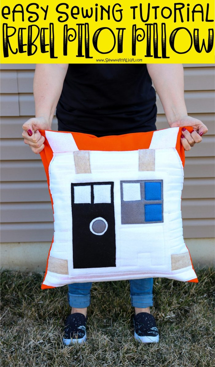 pictured woman holding star wars rebel pilot pillow