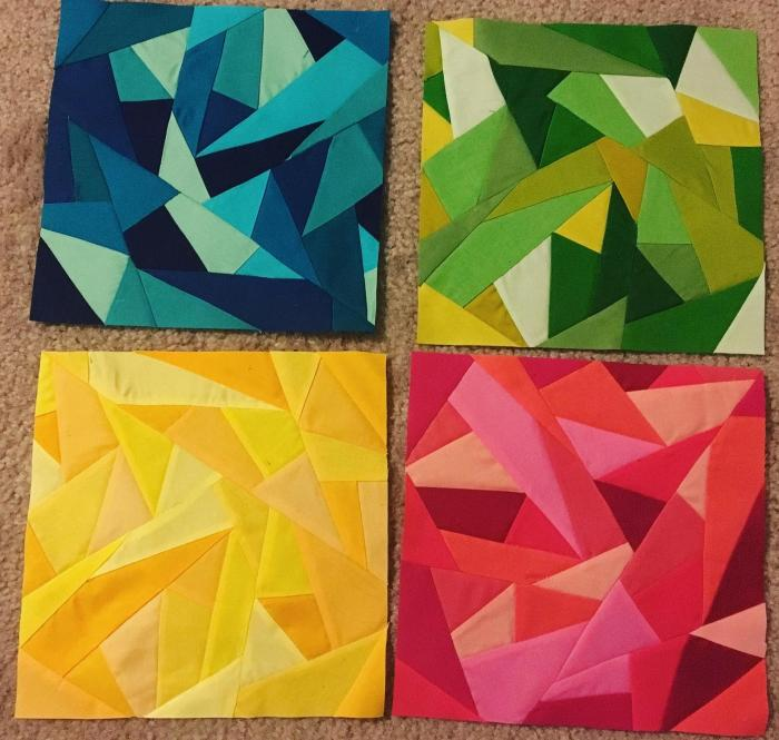 pictured four finished geometric improv foundation paper piecing blocks