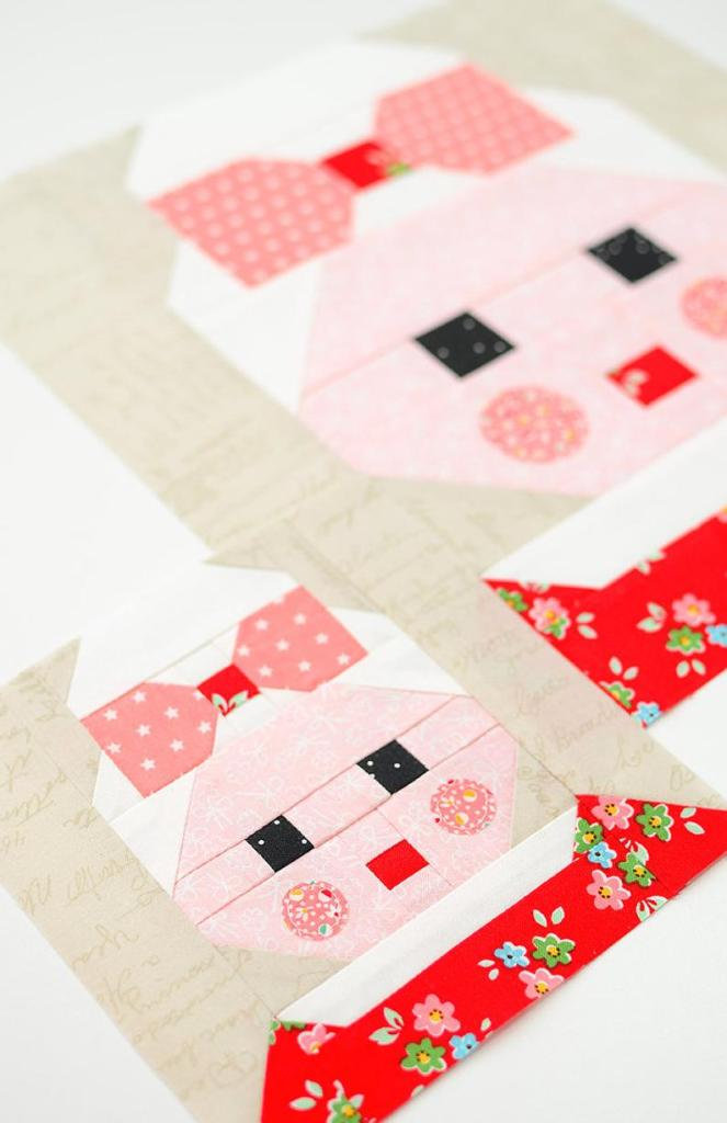 two mrs claus quilt blocks side by side