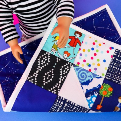 pictured patchwork quilt on dolls lap