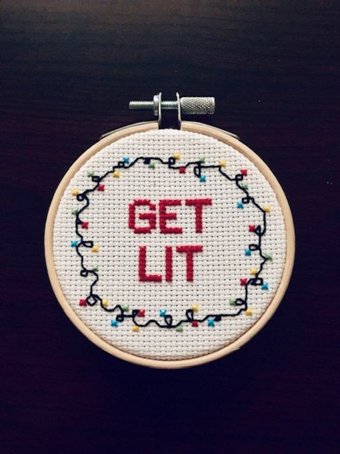 embroidery hoop with words get lit and christmas light strand