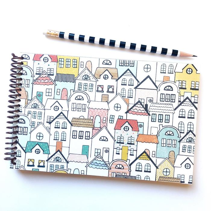 book with many houses on cover and black and white pencil