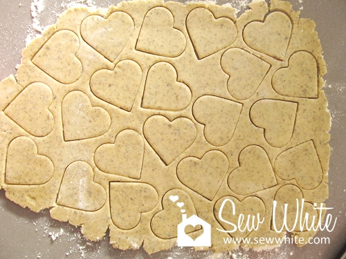 fresh biscuit dough with cookie cutter hearts ready to bake for the Lavender and Lady Grey Biscuits