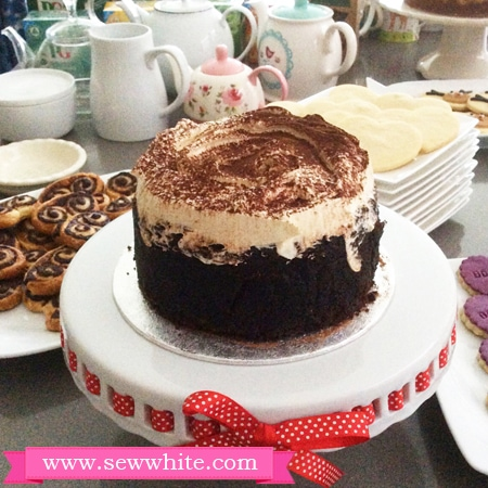 Guinness chocolate cake with cream decoration for the Battersea Dogs and Cats Home Afternoon Tea Party