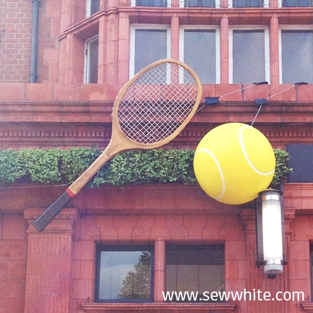 All bar one in Wimbledon ready for the tennis in 2015 with giant ball and racket hung up outside