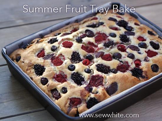 freshly cooked golden brown Summer Fruit Traybake still in the tin