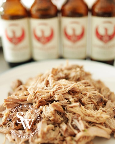 beer pulled pork read to eat with Wimbledon Brewery bottles in the background