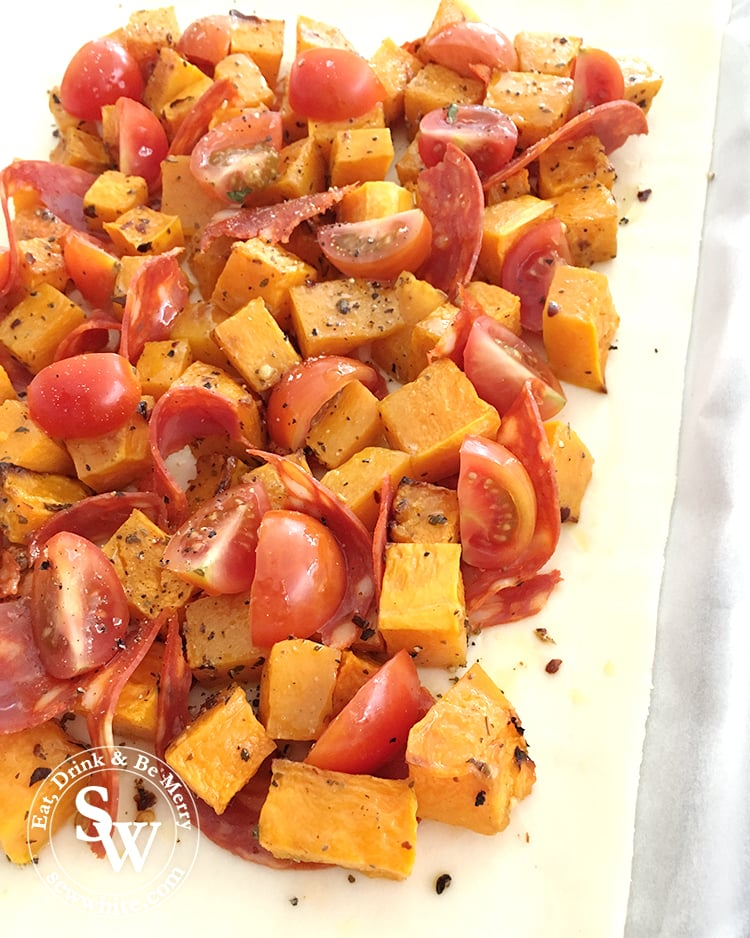 Roasted Butternut Squash on a puff pastry bed and topped with chorizo and tomato.
