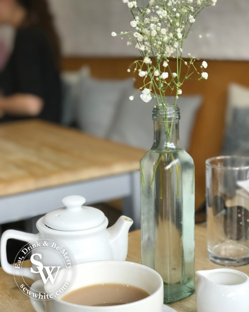 babys breath flowers on a table with tea at Coolangatta Wimbledon