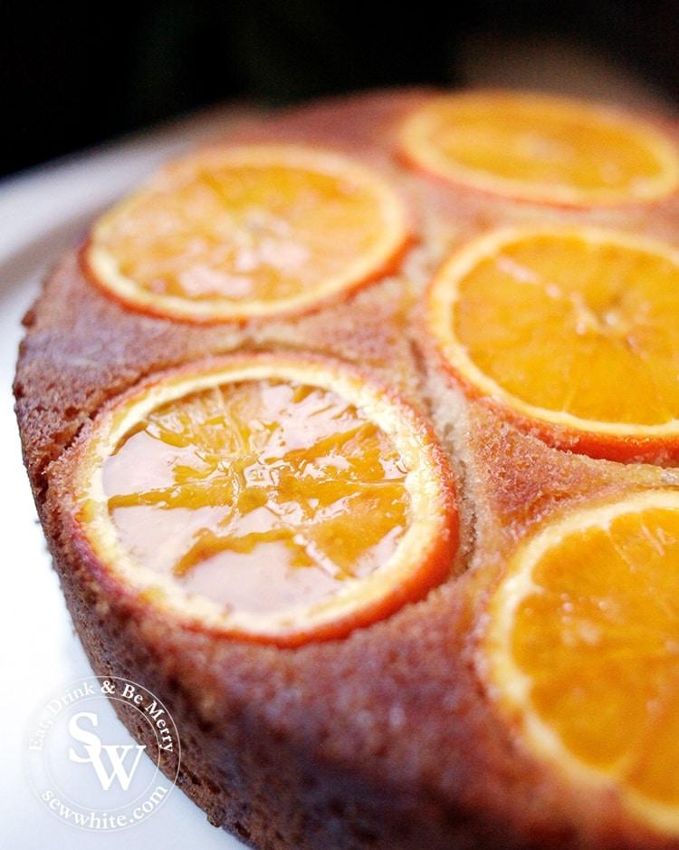 Glistening drizzle over the freshly baked Orange Drizzle Cake orange sponge.