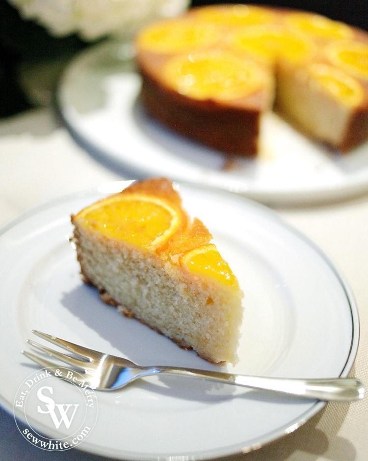A golden orange sponge slice ready to enjoy with silver pudding fork.