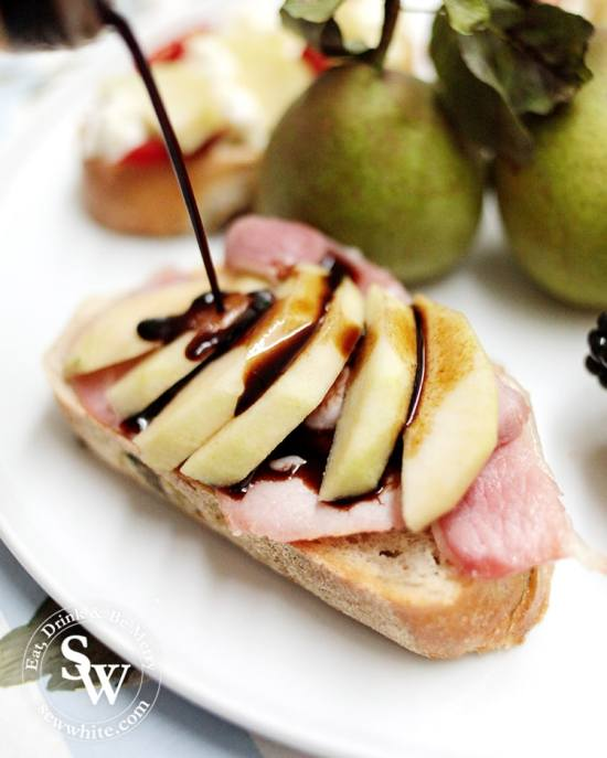Balsamic vinegar being poured over pears and bacon sourdough toast.