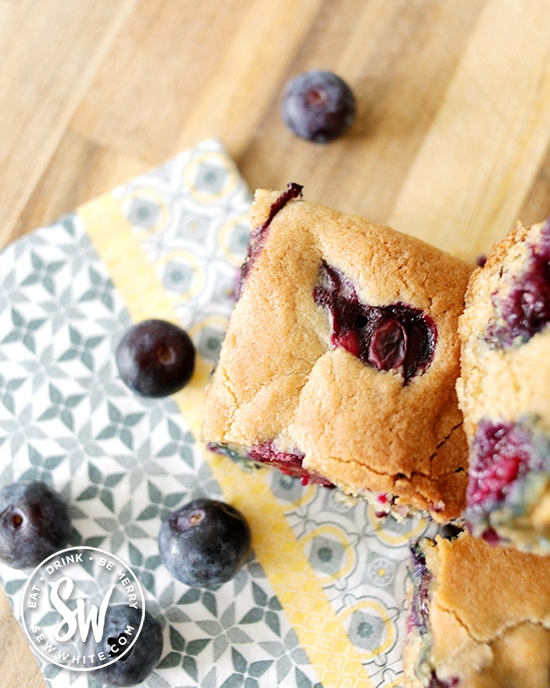 chunky cookie bake studded with blueberries surrounded with fresh blueberries