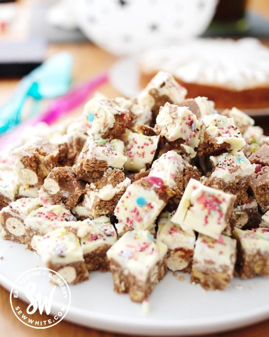 Party food of mini malteser bite size tray bake