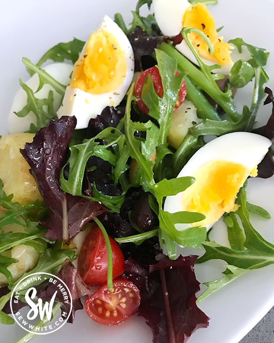 boiled egg salad with green beans, new potatoes, tomatoes and green and purple baby leaf salad , easy egg salad.