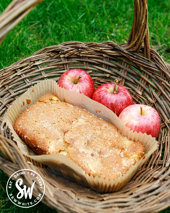 apple ginger cake in a wicker basket with fresh apples
