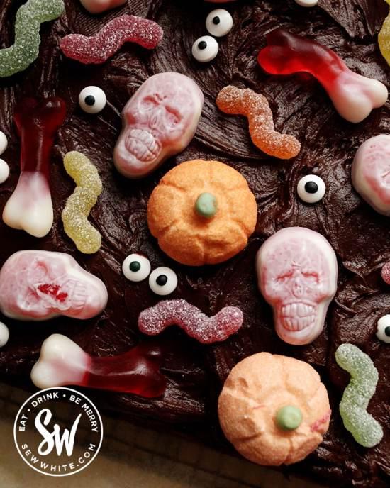 Chocolate Halloween Sheet Cake covered with chocolate ganache buttercream